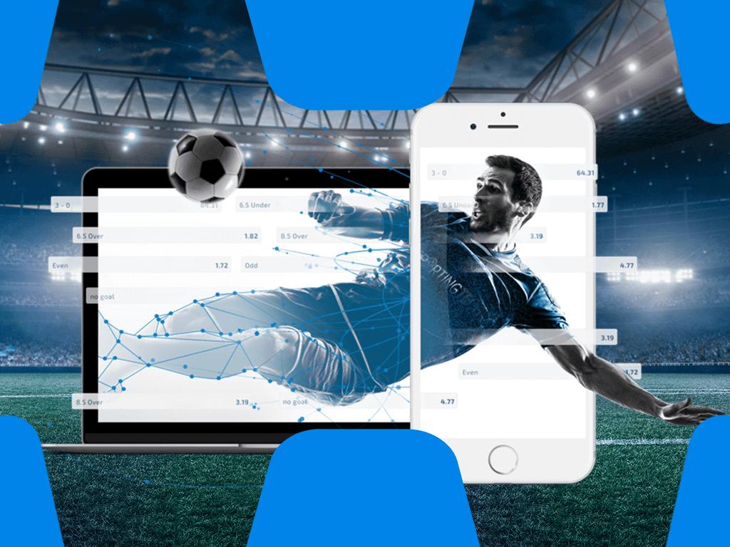 Fußballer in Seitfallzieher-Pose und mobile Geräte im Vordergrund